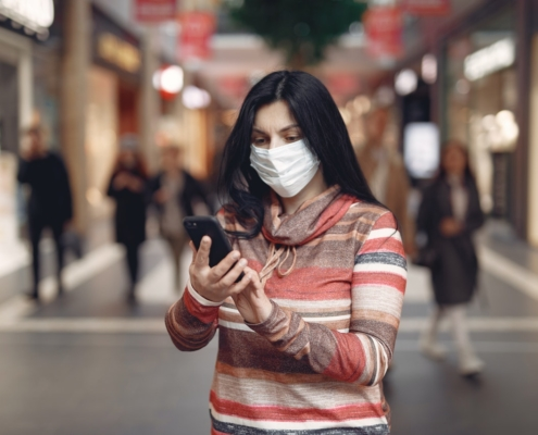 Woman with Mask and phone