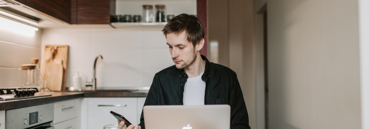 Man with laptop and phone